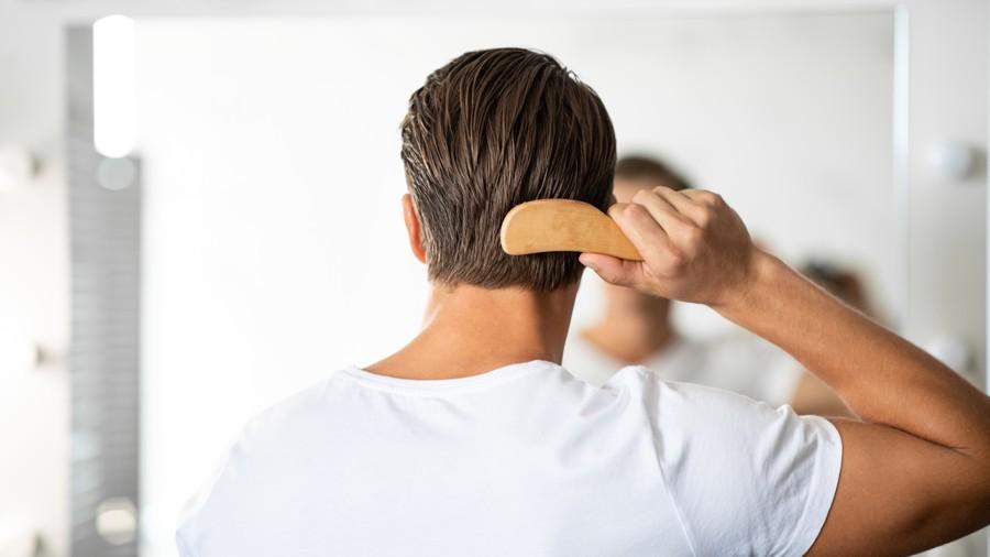 young man brushing his hair
