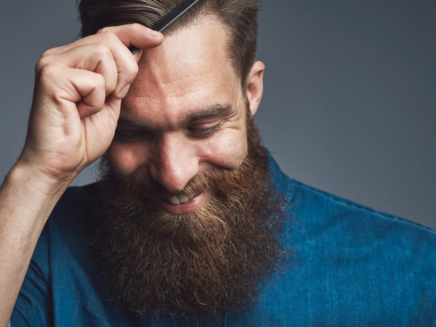 happy bearded man combing his hair YMRCS83